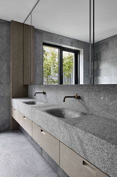 This modern master bathroom has smooth granite walls that create a natural appearance, while the basin and countertop have been engineered from a solid block of granite, creating a seamless finish. Diy Bathroom Remodel, Bathroom Interior, Budget Bathroom, Design Bathroom, Bathroom Ideas, Bad Inspiration, Bathroom Inspiration, Ideas Baños, Decor Ideas