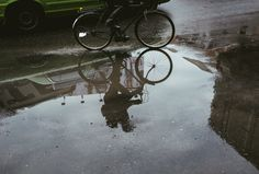 Bicycle reflections in a puddle. Love that this gives a different perspective and makes the image more interesting.