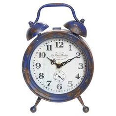 """Whether composed as a storied vignette or highlighted as an eye-catching statement piece, this chic design offers an effortless update for your home decor.Product: Clock Construction Material: Metal  Color: Distressed blue Dimensions: 9.25"""" H  Accommodates: (1) AA battery - not included"""