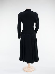 Dress  House of Balenciaga  (French, founded 1937)  Designer: Cristobal Balenciaga (Spanish, 1895–1972) Date: fall/winter 1947 Culture: French Medium: wool Dimensions: Length at CB: 49 in. (124.5 cm) Credit Line: Brooklyn Museum Costume Collection at The Metropolitan Museum of Art, Gift of the Brooklyn Museum, 2009; Gift of Mrs. Arthur A. Houghton, Jr., 1967