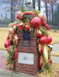 Holiday Mailbox Swag Design With Large Ornaments And Greenery