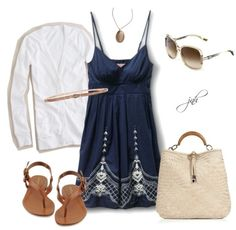 Fashion. Navy dress and white cardigan