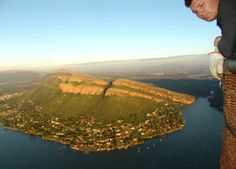 Hot air ballooning over the Hartbeespoort with Kosmos below.