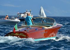 The perfect Classic Boating Lifestyle cruising Lake Tahoe during 8-12-12  weekend boat show on a Riva.