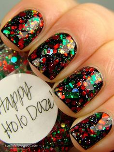 "Two coats of Lynnderella - Happy Holo Daze! over black.     ""The easiest way to describe this would be...Bottled Christmas. Yes. A hundred times better than Party Hearty. Red, green, silver, gold and holo glitters in all different shapes and sizes. Amazing!"""