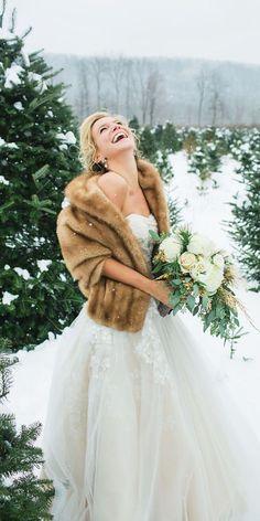 Brown Faux Fur Winter Bridal Wrap / http://www.deerpearlflowers.com/faux-fur-winter-wedding-ideas/