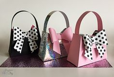 Create cute paper purse treat bags that are perfect for party favors, gift boxes, or decoration with this free pattern. The Paper Purse Party Favor is an adorably girly way to send your bachelorette party guests home with a little special something. Diy Paper Purses, Diy Paper Bag, Paper Gift Bags, Paper Gifts, Diy Gift Box, Diy Box, Diy Purse Gift Bag, Diy Gifts, Gift Boxes