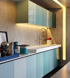 Shades of blue to the kitchen joinery in the AD House by Studio GT / Guilherme Torres.
