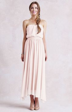 strapless chiffon dress with flowing, tea length skirt. Slight sweetheart neckline with gathering detail, boning, and slightly blousy fit.