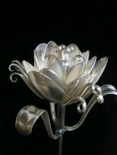 Beautiful flower sculpture made out of silver spoons