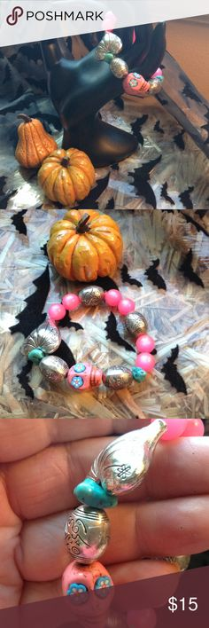 Sugar skull, silver heart, pink bracelet Welcome Halloween with this artsy sugar skull bracelet. Jewelry Bracelets