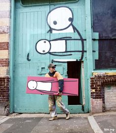 Stik, British street artist paint stick figure graffiti, cute, fun, water towers