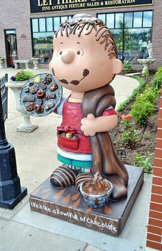 Linus Statue at Candyland in Stillwater, Minnesota, one of the many Peanuts on Parade statues you'll find across the state. This one, featuring Linus Blankets, entitled Life is Like a Bowl Full of Chocolates.