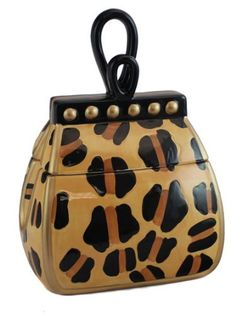 "Leopard Print Ceramic Handbag Cookie Jar by NM. $19.98. Not recommended for dishwasher and microwave. Stylish leopard print. Ceramic cookie jar. Measures 9""W x 6""D x 9""T. Exclusively from Neiman Marcus, comes this stylish ceramic Handbag Cookie Jar. Delightful even without treats inside, this eye-catching leopard print cookie jars take the shape of fancy handbags, with all the extra details.This handbag cookie jar is the perfect kitchen accent for any handbag enthuisest! Th..."