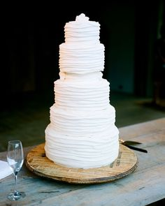 The simple, white, and modern wedding cake was created by Magpies Cakes.