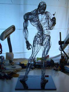 Wire man & bird