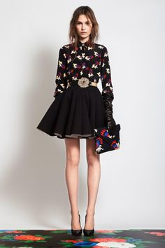 it's a very sweet idea at heart, but with forbidden elements i.e. black skirt (short), black leather gloves, etc. printed shirt, black skirt and flower belt