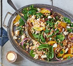 Orange & feta giant couscous salad. Pile this Middle Eastern-influenced salad onto platters to serve as part of a party spread