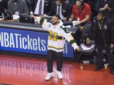 Drake wears Humboldt Broncos jersey to Raptors' playoff opener Good Heart, Scott Fitzgerald, Raptors, Crush Quotes, Ice Hockey, Broncos, People Like, Poetry Quotes
