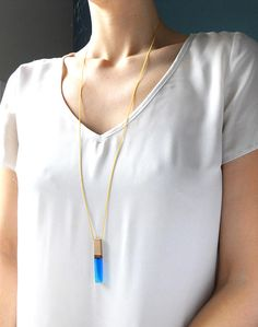 ABOUT----------  This stunning minimalist wood resin pendant is semi -transparent and catches the light beautifully whenever you move. This is an incredible, and unique, modern necklace.  A MUST HAVE item for any jewelry collection. Its super comfortable and looks wonderful alone or can be layered with other necklaces, it is easily mixed and matched with for a beautiful look. This piece was carefully poured into a mold where it is left to cure . Once was cured this pendant was hand sanded…