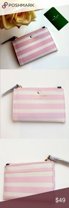Kate Spade Fairmount Square Cori Pink/Cream purse NWTs Kate Spade Fairmount Square Cori Pink/Cream Beach Coin PurseThis clever case from kate spade new york keeps important cards and keys right at your fingertips, plus it fits into your smallest handbag or coat pocket. Zipper closure Key ring Material: PVC kate spade Bags Wallets