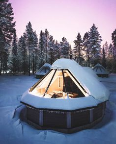 your guide to 15 winter glamping sites around the world aurora igloo huts photo