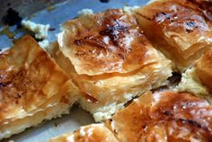 Mutabbaq: Middle-Eastern Pastry.  It's a phyllo pastry — think spanikopita — but stuffed with goat cheese and ricotta, then drenched in scented syrup just as it comes out of the oven, as with baklava. But unlike baklava, it's not such a fuss to assemble.
