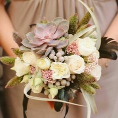 Unusual bouquet with succulent and roses