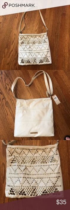 BCBGeneration Cross Body / Shoulder Bag NWT. color: foam, near white. Great bag! can be used as a cross body or shoulder bag with adjustable strap. Fun studded design on one side and reverse to the other and it is simple and chic. Looks like a very slight discoloration on the back side, see picture -otherwise great! Still has tissue inside and still has plastic sticker on the metal logo to keep from scratching. Interior has the perfect pockets all new:) BCBGeneration Bags
