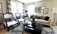The next model I toured was styled in very traditional furnishings in shades of olive, tan, cream and black. Here is the living room when you first walk inside. I do like the