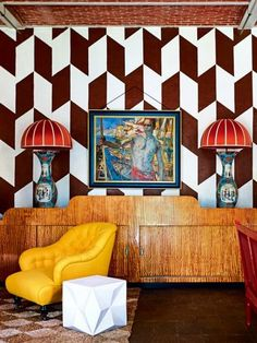 """House tour: a medieval fairytale house owned by an antique dealer and decorator: The interiors feature bold juxtapositions, bright colours, geometric motifs and a serious amount of flair. The furnishings are constantly changing as everything is for sale. In fact, the only place out-of-bounds to his clients is the kitchen, where Demeyer spends most of his time. """"I don't really need a house,"""" he quips. """"A bedroom and kitchen would do!"""""""