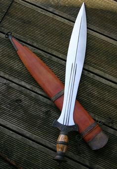 Celtic Leafblade triple fullered and tapered broad blade outfitted in antiqued bronze, birch and bone.