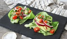salad-wraps- 1 butter lettuce or collard leaf bunch ½ haas avocado 1 tsp. chopped basil Small handful of spinach 1 tsp. cilantro, chopped ¼ red onion, diced 1 tomato, sliced or chopped Sea salt & pepper