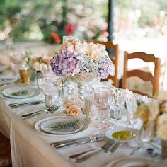 Ethereal #tablescape overflowed with lush blooms of garden roses, dahlias, dusty miller, and varying shades of hydrangeas.