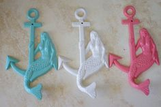 Hey, I found this really awesome Etsy listing at http://www.etsy.com/listing/115876025/beach-decor-mermaid-sitting-on-anchor