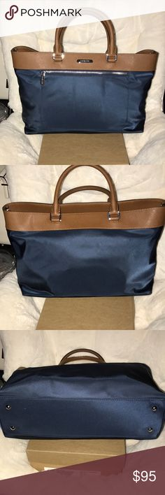 Michae Kors Large Nylon Tote This bag/tote is great for work and travel with its compartment making it convenient to stay stay organized.  It\'s almost new and I only used it for about a week until I bought a new laptop bag for work. Michael Kors Bags Totes