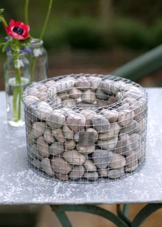 Miniature gabion designed for holding top heavy indoor bulbs. An incredibly sustainable design for retaining walls (seen at the Museum of Natural History in SLC, UT) which conforms to ground movement, dissipates energy from water seepage, and also increases in strength over time as the rocks settle and air voids decrease. I think I'll try to make one.