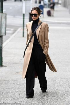 Beck to the fashion world! Victoria Beckham showed off her signature sophisticated style in a chic coat as she stepped out during New York Fashion Week