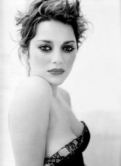 Marion Cotillard. Note to self...Standing as such, is sexy. Stand as such.