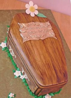The coffin is made out of red velvet and the man is made ...