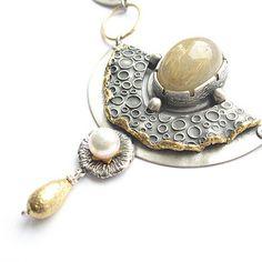Goldilocks necklace  by Fiann., via Flickr