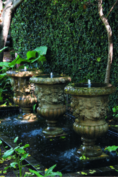 If there's one place where repetition work's it's in a water feature. While one of these classic urns would look attractive in this romantic garden at Morells Boutique Avenue, three makes a real statement. Outdoor Water Features, Water Features In The Garden, Garden Features, Garden Urns, Garden Fountains, Water Fountains, Outdoor Fountains, Formal Gardens, Outdoor Gardens