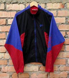 a2746a92d114 SALE Vintage 90s Nike Windbreaker Jacket by PopMartVintageGarage Nike  Windbreaker Jacket, Nike Jacket, Rain