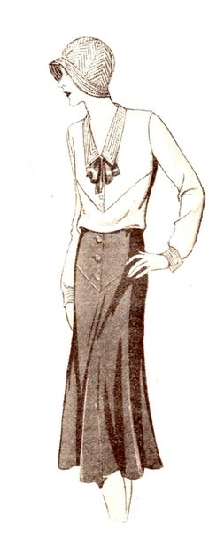 1930s Simple beige blouse trimmed very smartly on collar and cuffs with blue stitching to match the blue skirt. Both blouse and skirt have similar yoke effect.