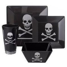 Set of black dishes with skulls