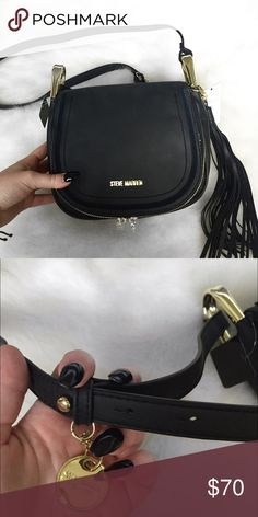 Steve Madden Bag Edgy and gorgeous black tassel Steve Madden Crossbody bag with gold accents. Holds a lot for a small bag because not only is there the inside of the purse (with a zippered pocket and a cell phone pocket) but the portion of the bag that folds over can be unzipped and used as another pocket! Adjustable straps; tassel detail can be removed. Has never been used/brand new, has very minor scuffs/scratches from handling but not at all noticeable! Steve Madden Bags Crossbody Bags
