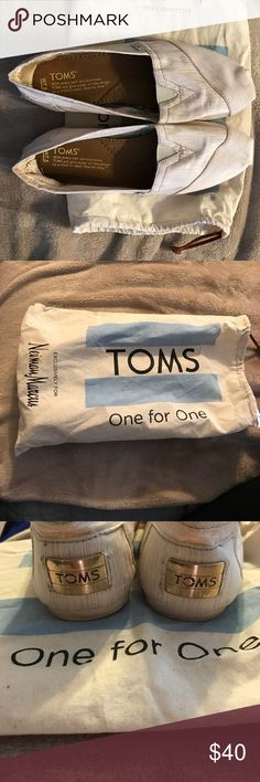 """Limited edition Toms 7.5 Neiman Marcus limited edition Women's 7.5 Toms. Worn twice. Beige and gold in color. Has gold metal plate """"TOMS"""" on the heel. Comes with dust bag! Make me an offer :) TOMS Shoes Slippers"""