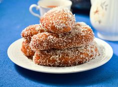 Mama's Traditional Koeksisters. These South African donuts are fried rolled in boiling syrup and then covered in shredded coconut. Donut Recipes, Cake Recipes, Dessert Recipes, Cooking Recipes, Oven Recipes, Milk Recipes, Easy Desserts, Bread Recipes, Recipies