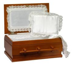 This elegant wooden pet casket is hand-crafted from oak wood and contains a high-quality white cloth lining and a plush white pillow. This casket is one of the finest pet caskets available in the USA Caskets For Sale, Pet Caskets, Pembroke Welsh Corgi Puppies, Baby Pugs, Buy Pets, Pet Loss, White Pillows, Pet Memorials, Hope Chest