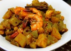 Click here for Bengali recipe of Lau Chingri or Shrimp and bottle gourd curry . Bengali lau chingri  recipe with step by step photos.